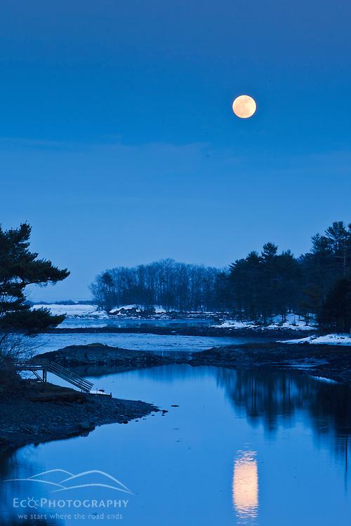 Moonrise over Chauncey Creek in winter. Kittery, Maine. Tidal creek. Maine Coast.