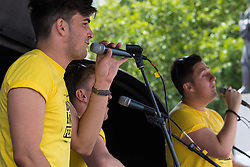 London, July 18th 2015.  Streetpop group The Taulormade perform on stage as part of the Busk in London Festival aimed at showcasing the outstanding talents of many of the capital's finest street performers, including, musicians, magicians, living statues and bands.