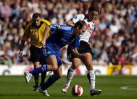 Photo: Daniel Hambury.<br />Fulham v Chelsea. The Barclays Premiership. 23/09/2006.<br />Fulham's Michael Brown tackles Chelsea's Arjen Robben.
