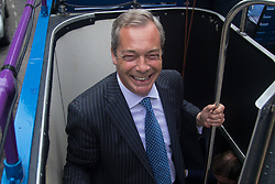 """Smith Square, Westminster, London, June 16th 2016. UKIP leader Nigel Farage launches his """"biggest ever"""" advertising campaign as Leave and Remain enter their last week of campaigning before the EU referendum on June 23rd. PICTURED: Nigel Farage boards the UKIP battle bus."""