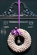 Decoration of quails egg shells on ornate front door in Edam, The Netherlands