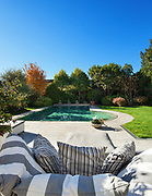 Architecture; beautiful garden with pool, view from the armchair