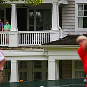 CHARLOTTE, NC - August 11, 2017:  Residents of Quail Hollow Club stand on their balcony and watch John Daly tee off #5 at the 2017 PGA Championship at Quail Hollow. CREDIT: LOGAN R. CYRUS FOR CHARLOTTE MAGAZINE