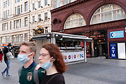 With most shops now open but with retail sales suffering due to the Coronavirus pandemic, shoppers wearing face maks, which will become compulsory in shops on the 24th July, still come to Oxford Street, Londons main shopping district on 16th July 2020 in London, United Kingdom. Coronavirus or Covid-19 is a respiratory illness that has not previously been seen in humans. While much or Europe has been placed into lockdown, the UK government has put in place more stringent rules as part of their long term strategy, and in particular social distancing.