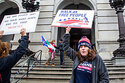 """Pauline Bauer holds a sign during a """"Stop the Steal"""" rally in Harrisburg, Pennsylvania on January 5, 2021. Supporters of President Donald Trump urged legislators to decertify the election during the rally at the Pennsylvania State Capitol. (Photo by Paul Weaver)"""