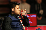 Liang Wenbo (Chn) taking a drink. Ronnie O'Sullivan v Liang Wenbo, 1st round match at the Dafabet Masters Snooker 2017, day 1 at Alexandra Palace in London on Sunday 15th January 2017.<br /> pic by John Patrick Fletcher, Andrew Orchard sports photography.