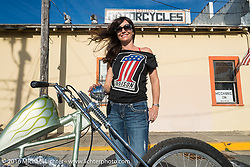 Kelly Simmons took a break from working the counter during the Biltwell Bash at Robison's Cycles. Daytona Bike Week 75th Anniversary event. FL, USA. Friday March 11, 2016.  Photography ©2016 Michael Lichter.