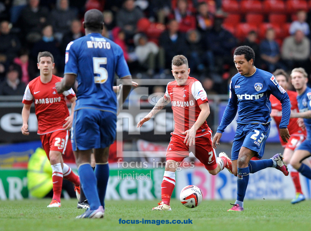 Picture by Alan Stanford/Focus Images Ltd +44 7915 056117.27/04/2013.Dean Cox (7) of Leyton Orient and Korey Smith of Oldham Athletic during the npower League 1 match at the Matchroom Stadium, London.. .