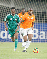 Photo: Steve Bond/Richard Lane Photography.<br />Nigeria v Ivory Coast. Africa Cup of Nations. 21/01/2008. Abdouleye Meite (R) takes tha ball forward followed by John Obi Mikel (L)
