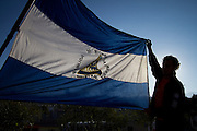 """A Nicaraguan migrant holds a flag of his country in the migrant shelter """"Posada Migrante Belén"""", in Saltillo, Coahuila on October 20th, 2012. (Photo: Prometeo Lucero)"""