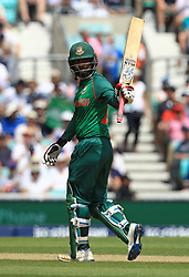 Bangladesh's Tamim Iqbal acknowledges reaching 50 runs during the ICC Champions Trophy, Group A match at The Oval, London.