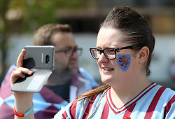An Aston Villa fan takes a photograph during the Sky Bet Championship Final at Wembley Stadium, London.