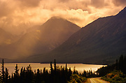 Tutshi Lake at sunrise with storm light in the Coast Mountains. South of Carcross in the Yukon<br />