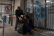 """A security guard gives masks to a woman from Guatemala and her two daughters, who were apprehended upon crossing the US-Mexico border between El Paso, Texas and Ciudad Juárez, Mexico, and immediately """"expelled"""" back to Mexico in the early hours of April 2, 2020 at the Paso del Norte International Bridge in Ciudad Juárez in the state of Chihuahua, Mexico. Under emergency coronavirus measures, United States Border Patrol can now immediately return undocumented immigrants who crossed the US-Mexico between a port of entry, """"to help prevent the spread of COVID-19,"""" according to a video posted on a Border Patrol twitter account. Detainees coming from Mexico, Guatemala, El Salvador and Honduras must only be fingerprinted, then they are sent back to Mexico at the closest port of entry."""