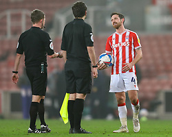 Joe Allen of Stoke City speaks to referee David Webb after the final whistle - Mandatory by-line: Nick Browning/JMP - 03/03/2021 - FOOTBALL - Bet365 Stadium - Stoke-on-Trent, England - Stoke City v Swansea City - Sky Bet Championship