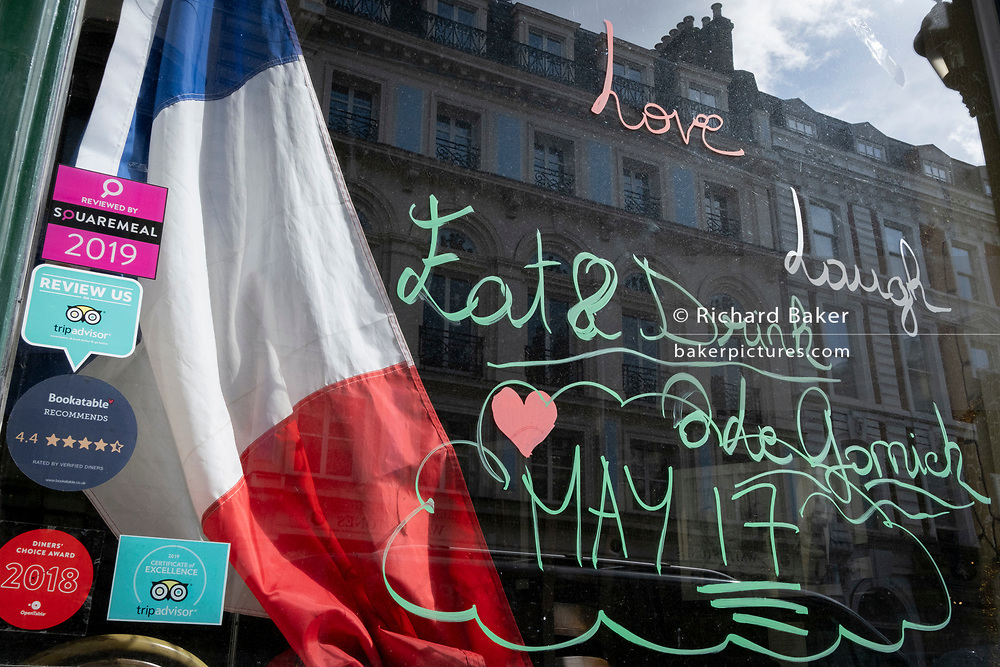 Days before the third Coronavirus lockdown ends, and non-essential retailers and shops re-open again, a welcome message has been written to customers returning to a French restaurant near Covent Garden, on 9th April 2021, in London, England.