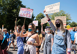 "© Licensed to London News Pictures; 08/08/2020; Bristol, UK. NHS Workers say NO! at a 'Bristol for Pay Justice' rally and march held in solidarity with health and social care workers across the UK demanding fair recognition of everyone in the NHS family and their tireless work throughout the pandemic. The campaign says ""If you clapped for us, please come and stand with us."" The campaign says it is a disgrace that so many health and social care staff who worked so hard and risked their lives have been overlooked in the public sector pay rise, and that without nurses, health care assistants, porters, cleaners and the whole NHS family the UK could not have made it through. The campaign says that for too long this work has been underpaid and undervalued and now the UK government is squeezing the NHS from all sides; they say NO to privatisation, deliberate underfunding, low wages and poor conditions. Organisers asked that all attendees respect social distancing as much as possible and with a planned route that gives as much space as possible and that mask wearing will be mandatory with masks available on the day for those that don't have them. Attendees are asked to wear blue, or a blue ribbon in solidarity. Photo credit: Simon Chapman/LNP."