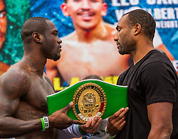 LOS ANGELES, CA - DEC 14: 2008 Olympic Bronze Medalist boxer Deontay ?Bronze Bomber? Wilder (Left) and  undefeated boxer Kelvin Price (Right) at the Khan vs Molina official weigh-in at the Los Angeles Sports Arena in Los Angeles, CA 2012/12/14. Byline, credit, TV usage, web usage or linkback must read . Byline and/or web usage link must  read PHOTO: © Eduardo E. Silva/SILVEX.PHOTOSHELTER.COM.