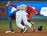 The Angels' Johnny Giavotella is upended by the Dodgers' Yasiel Puig during the Angels' Freeway Series game against the Dodgers Thursday night at Dodger Stadium.<br /> <br /> ///ADDITIONAL INFO:   <br /> <br /> freeway.0401.kjs  ---  Photo by KEVIN SULLIVAN / Orange County Register  --  3/31/16<br /> <br /> The Los Angeles Angels take on the Los Angeles Dodgers at Dodger Stadium during the Freeway Series Thursday.<br /> <br /> <br />  3/31/16