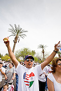 10 APRIL 2006 - PHOENIX, AZ: An immigrant cheers an immigration reform rally in Phoenix, AZ. More than 200,000 people participated in a march for immigrants's rights in Phoenix Monday. The march was a part of a national day of action on behalf of undocumented immigrants. There were more than 100 such demonstrations across the US Monday. Protestors were encouraged to wear white, to symbolize peace, and wave American flags, to demonstrate their patriotism to the US.  Photo by Jack Kurtz