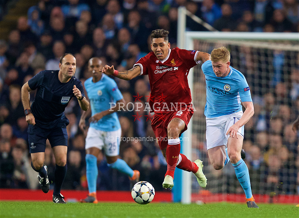 MANCHESTER, ENGLAND - Tuesday, April 10, 2018: Liverpool's Roberto Firmino (left) tackles Manchester City's Kevin De Bruyne (right) during the UEFA Champions League Quarter-Final 2nd Leg match between Manchester City FC and Liverpool FC at the City of Manchester Stadium. (Pic by David Rawcliffe/Propaganda)