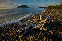 Hiri Island viewed from a volcanic rock beach on Ternate Island, North Moluccas, Indonesia.