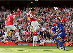 11.09.2010, Emirates Stadium, London, ENG, PL, FC Arsenal vs Bolton Wanderers, im Bild Arsenal's Marouane Chamakh  heads in for the 2-1 despite a dive from  Bolton's keeper  Adamm Bogdan and celebrates with debuttant Arsenal's Sebastien Squillaci.  EXPA Pictures © 2010, PhotoCredit: EXPA/ IPS/ Marcello Pozzetti +++++ ATTENTION - OUT OF ENGLAND/UK +++++ / SPORTIDA PHOTO AGENCY