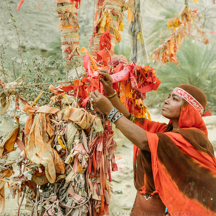 Colorful cloth are tied to branches by pilgrims, for good wishes. The area surrounding the main shrine of Hinglaj, the goal of the pilgrimage.
