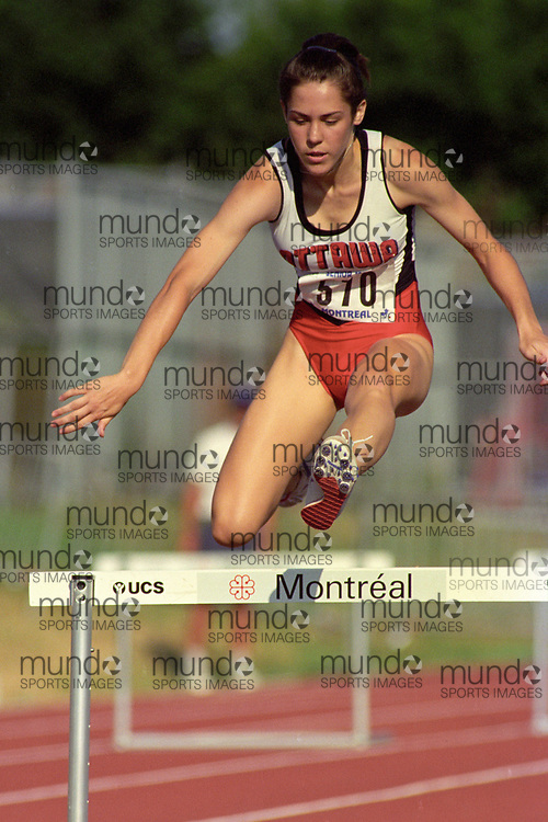 (Montreal, Canada---28 July 1995) Isabelle Gervais competes in the 400m hurdles at the 1995 Canadian National Track and Field Championships. Photo 1995 Copyright Sean Burges / Mundo Sport Images.