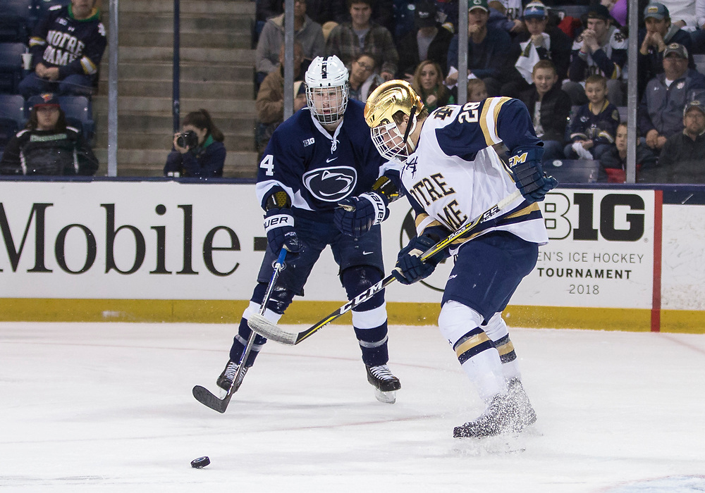 March 10, 2018:  Penn State defenseman Kris Myllari (4) and Notre Dame forward Jack Jenkins (28) battle for the puck during NCAA Hockey game action between the Notre Dame Fighting Irish and the Penn State Nittany Lions at Compton Family Ice Arena in South Bend, Indiana.  Notre Dame defeated Penn State 3-2.  John Mersits/CSM