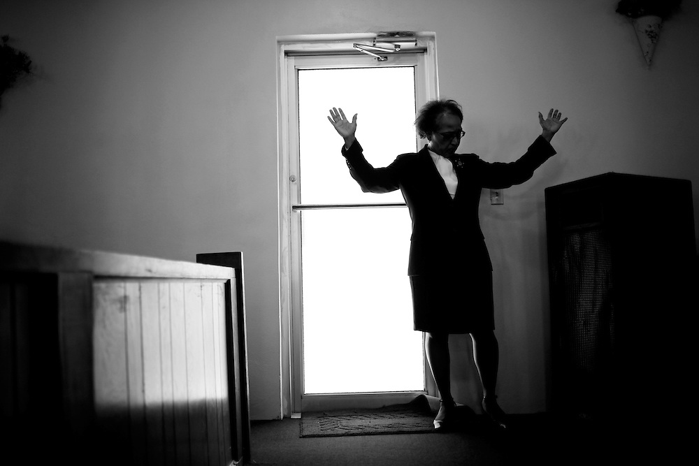 A member of Macedonia Missionary Baptist Church prays for her community during worship service in Naples. Macedonia started serving the black community in Naples in 1929.