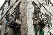 Stone walls, window shutters and wrought iron baroque balconies. Sibenik, Croatia