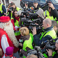 Finnish man dressed as Santa Claus named Joulupukki in Finland talks to members of the press after he arrives to participate in the traditional Christmas celebrations in Budapest, Hungary on November 30, 2012. ATTILA VOLGYI