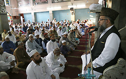 June 26, 2017 - Lahore, Punjab, Pakistan - Pakistani faithful Muslims offer Eid al-Fitr prayer at the Jamia Naeemia Mosque in Lahore. Muslims around the world are celebrating the Eid al-Fitr  festival, marking the end of the fasting month of Ramadan. (Credit Image: © Rana Sajid Hussain/Pacific Press via ZUMA Wire)