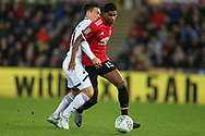 Roque Mesa of Swansea city (l) challenges Marcus Rashford of Manchester Utd (r). EFL Carabao Cup 4th round match, Swansea city v Manchester Utd at the Liberty Stadium in Swansea, South Wales on Tuesday 24th October 2017.<br /> pic by  Andrew Orchard, Andrew Orchard sports photography.