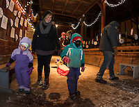 Maya, Susan and Chloe Bosk have their lanterns lit and ready for the adventure walk at Prescott Farm during the Lantern Festival on Saturday evening.  (Karen Bobotas/for the Laconia Daily Sun)