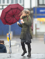© Licensed to London News Pictures. 07/12/2018. Pettswood, UK. The wind catches commuters umbrella. London commuters brave the cold,wet and windy weather at Pettswood train station,Pettswood this morning .Photo credit: Grant Falvey/LNP
