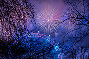 New Years Eve fireworks light up the Millennium Wheel from St Jamess Park on the 1st January 2020 in London in the United Kingdom.