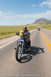 Jeff Hampton riding his Harley-Davidson south on highway 79 toward Sturgis during the annual Sturgis Black Hills Motorcycle Rally. SD, USA. August 3, 2014.  Photography ©2014 Michael Lichter.
