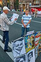 Ukraine, Kiev, Avenue Khreshchatyk Vulytsya. Peintre caricaturiste. // Ukraine, Kiev, Khreshchatyk Vulytsya avenue. Caricaturist.
