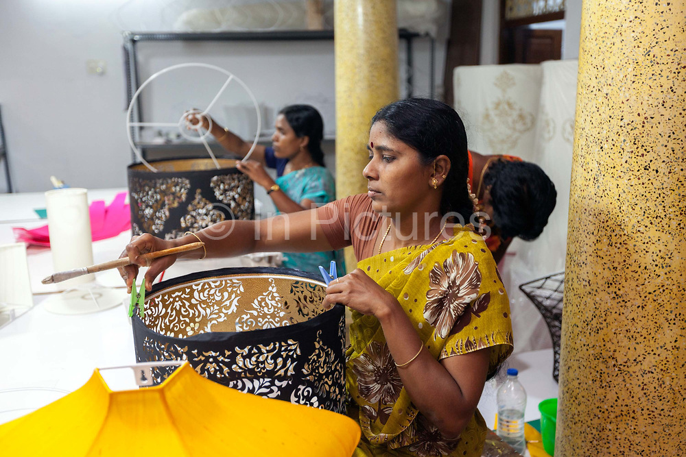 Workers assemble designer lamp shades at Pondymania - a family run company designing and producing handcrafted lights and lighting accessories. Pondicherry, India<br /> Pondicherry now Puducherry is a Union Territory of India and was a French territory until 1954 legally on 16 August 1962. The French Quarter of the town retains a strong French influence in terms of architecture and culture.