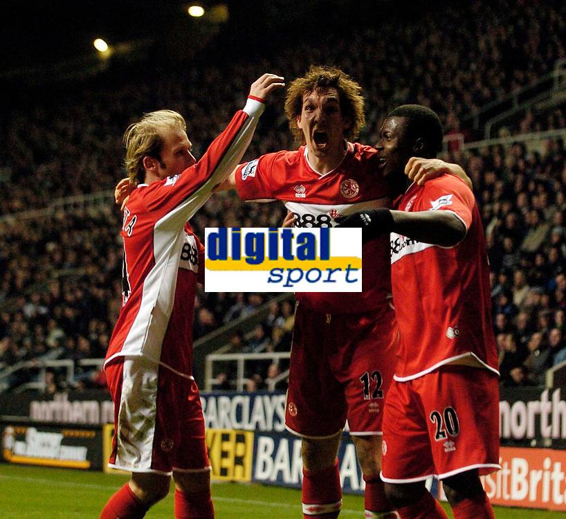 Photo: Jed Wee.<br />Newcastle United v Middlesbrough. The Barclays Premiership. 02/01/2006.<br />Middlesbrough's Emanuel Pogatetz (C) and Gaizka Mendieta (L) celebrate with goalscorer Yakubu.