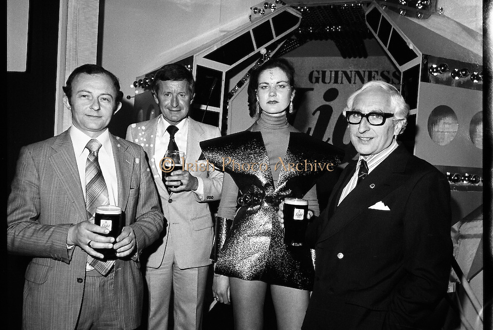 """Guinness Launch """"Guinness Light"""".  (M79)..1979..26.06.1979..06.26.1979..26th June 1979..At the Guinness Theatre in St James Gate Brewery,Guinness launched """"Guinness Light"""". With a spectacular show Guinness brought to the market a new lighter version of its world famous stout. it is hoped that it will fill a niche with younger drinkers frequenting Ireland's pubs and clubs..Image taken at the launch of the New Guinness Light Stout were Gerry Murtagh, Murtagh's Bar,Lusk, Greg Cunnigham Area Manager, G.G.S.,Siobhan McCabe and Eric Wardrop,Area Sales Manager,Limerick."""