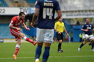 John Brayford of Cardiff City taking a shot. Skybet football league championship match , Millwall v Cardiff city at the Den in Millwall, London on Saturday 25th October 2014.<br /> pic by John Patrick Fletcher, Andrew Orchard sports photography.