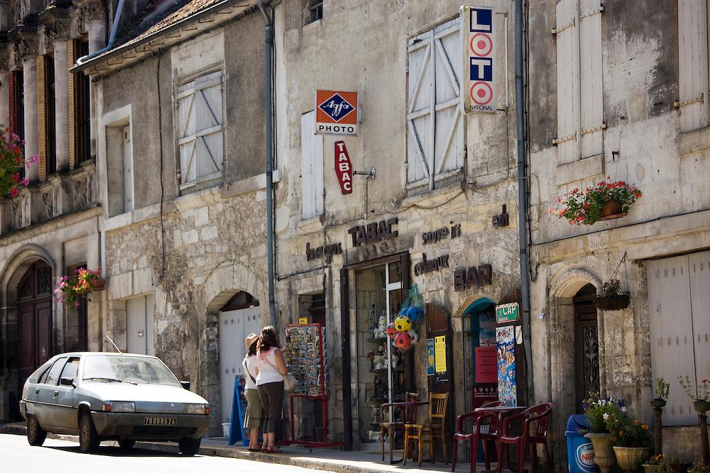 Tourists in quaint town of Bourdeilles popular tourist destination near Brantome North Dordogne, France