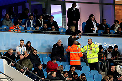 A fan is stopped from taking a selfie in the stands near Lionel Messi and Sergio Aguero by stewards