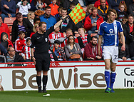 referee holds up his flag during the English League One match at Bramall Lane Stadium, Sheffield. Picture date: April 30th, 2017. Pic credit should read: Jamie Tyerman/Sportimage