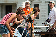 Middletown, New York - A women view a partical solar eclipse through a solar telescope on Alumni Green at SUNY Orange on Aug. 21, 2017.