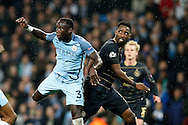 Manchester City's Bacary Sagna (3) and Celtic's Moussa Dembele (10) during the Champions League match between Manchester City and Celtic at the Etihad Stadium, Manchester, England on 6 December 2016. Photo by Craig Galloway.