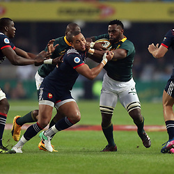 Siya Kolisi of South Africa hands off Gael Fickou of France during the 2nd Castle Lager Incoming Series Test match between South Africa and France at Growthpoint Kings Park on June 17, 2017 in Durban, South Africa. (Photo by Steve Haag Sports)